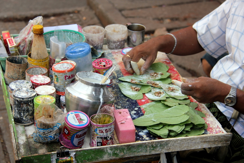 Betel nut is prepared on the street in Yangon